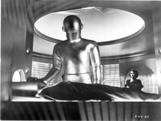 Gort the robot (Martin Lock) revives the dead Klaatu (Michael Rennie) in his spaceship as boarding house owner Helen Benson (Patricia Neal) looks on, in The Day the Earth Stood Still. Sf Movies, Movie Tv, Horror Movies, Robert Wise, France Culture, Classic Sci Fi, Classic Movies, Sci Fi Films, Popular Music