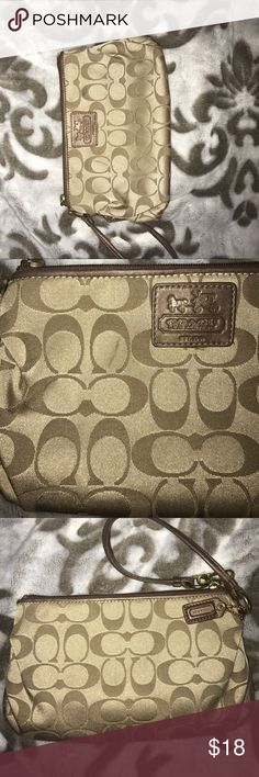 Coach Wristlet Pewter and Gold Coach Wristlet previously loved. Has a few marks on outside. Please see pictures. Coach Bags Clutches & Wristlets
