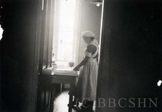 Unidentified Nurse in the Supply Room, 2nd Floor. Image courtesy of the Barbara Bates Center for the Study of the History of Nursing.