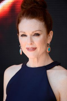 """Julianne Moore wore a delightful pair of color-block dangling earrings to the 'Hunger Games"""" Mockingjay Part 1' photocall."""