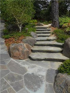 TIP: Cantilever flagstone step treads to make them appear to float.