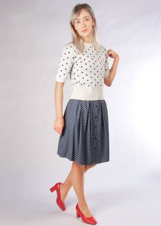 We've paired our super soft cotton polka knit with our buttoned, pleated Tilde skirt for a comfortable but stylish 1950s inspired look. We finished off the outfit with a pop of red by adding a pair of classic heels. Vintage Inspired Outfits, Vintage Style Dresses, Irish Design, Made Clothing, 1950s, Midi Skirt, Vintage Fashion, Pop, Stylish