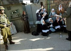 Palestinian Resistance المقاومة الفلسطينيه Israeli Soldiers stop Palestinian school-girls from going to school, Al Khalil-Hebron. You don't want us to go to school, fine we'll have school here.