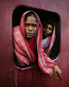 Steve McCurry. Woman and child on the Howrah Mail train en-route to Kolkata West Bengal (1982). The Steve McCurry: India exhibition will open @RubinMuseum on November 18 2015 in partnership with @ICP. The exhibition will showcase@SteveMcCurryOfficials photographs of India in a museum for the first time featuring a combination of portraits landscapes and documentary imagery that express his curiosity and commitment to capturing unexpected moments. #McCurryIndia by icp