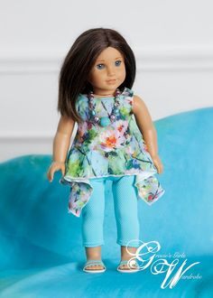 Listing is for a sleeveless tunic top, leggings and necklace  This tunic shirt is made from a fun floral knit fabric. The leggings are capri