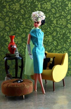 Silkstone Barbie in a custom turquoise dress and cape! ... with an amazing floral hat. Standing in front of a cool chair Church's Must by ernestopadrocampos
