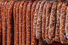 Various types of romanian sausages carnati , smoked and dried, exposed for sale Shall specify for the month of December Homemade Biscuits Recipe, Homemade Sausage Recipes, Halloumi Burger, Cookbook Recipes, Cooking Recipes, Chorizo, Romania Food, Tapas, Hungarian Recipes