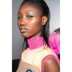 0e3335de1b47 Crystalstudded wings came flying down the runway at Prada and makeup artist  Pat McGrath used one