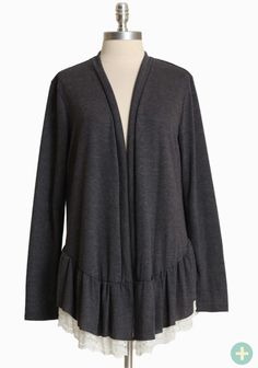 """Winter Light Curvy Plus Lace-trimmed Cardigan 34.99 at shopruche.com. This charcoal gray cardigan is perfected with a soft heathered knit, a hint of stretch, and a ruffled hem with peek-a-boo lace trim in ivory.68% Polyester, 29% Rayon, 3% Spandex, Made in USA, Approx. 31"""" length from top of shoulder"""