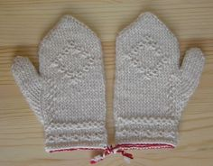 These mittens will fit a child size 4-6, measuring 7 in length and 3.25 in width above the thumb. They are made of wool in the traditional method of Swedish Twined Knitting (Tvåäandsstickning). The little red and white braids serve to keep the mittens tied together when they are not being worn so one wont get lost. The embossed motifs are particular to this type of knitting. The thumb construction is unique, called a crooked thumb gusset.    Care instructions: These mittens are made from…