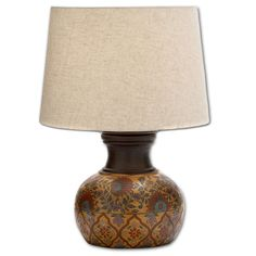 Old-world appeal comes to the living room with the Adela lamp from Casa Cortes. Beautiful hand painted floral rosettes and unique patterns enhance the table lamp's terracotta base.