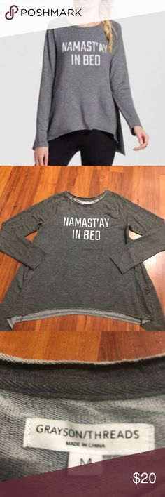 Namast'ay in bed shirt by Grayson Threads Namast'ay in bed shirt nwot, size M. Brand: Grayson/Threads. No stains/holes/rips. Material tag posted. Super soft! Price negotiable! Grayson Threads Tops