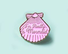 "Super cute, magical, pastel pink pin made from gold enamel. This gorgeous pin is engraved with the super cute words ""I'm Really a Mermaid"" in the centre and is inspired by my love of mermaids. I hope you enjoy wearing it as much as I enjoyed designing it!"