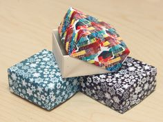 Scrap paper gift boxes - we used to make these out of christmas cards!
