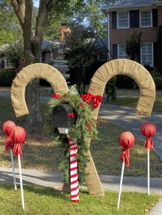 Mailbox Decor To turn this basic mailbox into a showstopping focal point, Dan surrounded it with giant candy canes made from plywood and burlap as well as lollipops made from PVC, small bouncy balls, colored burlap and twine