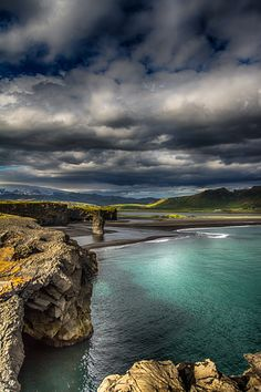 The cliff on Kirkjufjara - View towards the cliff on Kirkjufjara beach located on the south-Coast of Iceland.