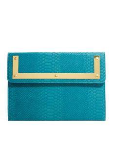 Image from http://cdn2.picvpicimg.com/pics/3974791/teal-asos-asos-croc-clutch-bag-with-metal-frame.jpg.