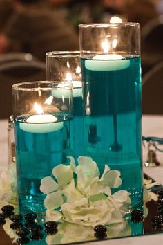Centerpieces from our wedding. A little bit of food color & water with some floating candles. Cylinders from dollar store. Centerpieces from our wedding. A little bit of food color & water with some floating candles. Cylinders from dollar store. Trendy Wedding, Diy Wedding, Dream Wedding, Wedding Day, Wedding Reception, Wedding Flowers, Wedding Blue, Wedding Beach, Reception Food