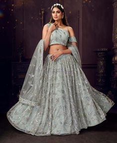 girls! The Bridesmaids are not to be ignored, this wedding season. After all, they are the ones stealing the spotlight after the couple getting married. In an Indian traditional wedding, there are a number of ceremonies to be held apart from the wedding. So, VenueMonk brings you some apparel trends, straight from the ramp! Let's have a look: Blue Lehenga, Net Lehenga, Lehenga Choli Online, Bridal Lehenga Choli, Bollywood Lehenga, Indian Bridal Lehenga, Lehenga Blouse, Indian Dresses, Indian Outfits