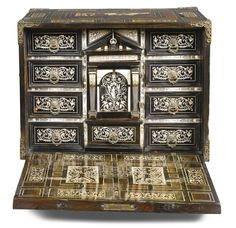 A North Italian ivory inlaid ebony, rosewood and marquetry table cabinet, Lombard first quarter 17th century  SOLD. 5,000 GBP