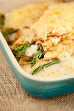 Chicken and asparagus crepes!Thinking of making this this weekend....    Update: I made these tonight and wowee!! I substituted cream of chicken soup for cream of mushroom since I don't like mushrooms.  Instead of fontina cheese (which is really expensive) I used provolone. AWESOME!