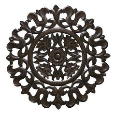 "Carved Wood Wall Panel will add a pop of style to any room in your home. The dark wood is carved into an intricate flowing design with a single stunning blossom at the center. It's a gorgeous stand-alone piece or the perfect addition to a collection of wall art. Easily add this carving to your wall with ready-to-hang hooks, included in the package. Measures 29.5H""x0.5W""x 29.5D""."