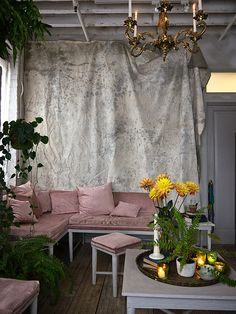 Bellocq, as featured on DesignSponge. The muted tones married with the greenery creates understated luxury.