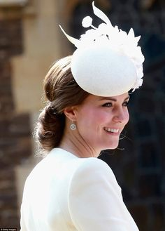 Kate dressed in an ivory Alexander McQueen outfit with Jane Taylor hat at Princess Charlotte's christening.