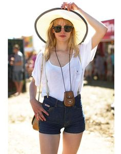 Her wide-brimmed hat, leather pouch and suspenders are inducing major accessory envy.