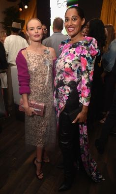 """Kate Bosworth and Tracee Ellis Ross went glam in pink flourished ensembles, as they chatted at the gala. In a unique move, Kate wore a plastic covered Raf Simons' debut Calvin Klein Collection dress. """"I feel very honored to be wearing this,"""" she told HELLO!."""