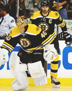 Tuukka Rask and Zdeno Chara...chara is 6'9 the worlds tallest hockey player of all time . Oh don't worry he can smash u against the boards really easy and looks taller in skates :0WOW