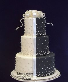 This is almost my wedding cake except for mine was red and white and squared.