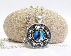 hypnotic Dragon Eye Necklace, by LMRPhotography, $17.00 USD #dragon eye https://www.zibbet.com/lmrphotography/dragon-eye-necklace-fantasy-necklace-blue-dragon-eye-necklace