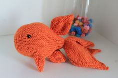 A new handmade orange knitted goldfish with beautiful long tails  This is a pattern of my own invention, he has been made using 4mm double