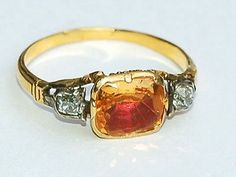 Georgian ring circa 1780 - the high carat gold shank supporting a golden Imperial topaz set over cerise foil in a closed back setting. Victorian Jewelry, Vintage Jewelry, Gold Jewelry, Jewelry Rings, Imperial Topaz, Mourning Jewelry, Jewelry Cabinet, Anniversary Jewelry, Egyptian Jewelry