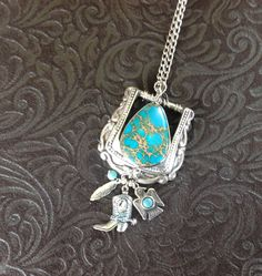 Long vintage silver belt buckle with turquoise pendant and dangle of western charms by CrowsFeetStudio on Etsy