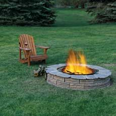 """""""Looking for a cheap, moderately easy snd *safe* firepit to build.     """"I got a metal corrugated fire ring from a garden place in Michigan (think drainage pipe) 30x12 it was $20.00. Dug a hole 6"""" deep, poured in rock, sand and surrounded it with bricks - $80. Looks exactly like the one in the picture. Wasn't hard, and I'm a 45 year old woman!""""."""
