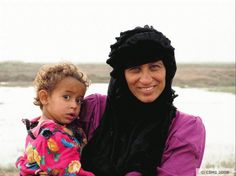 A woman from southern Iraq Marshes of Iraq with a ch A woman from southern Iraq Marshes of Iraq with a child in traditional dress southern These faces are Iraqi Women, Ancient Mesopotamia, Traditional Dresses, Melting Pot, Culture, Children, Mothers, Jewel, People