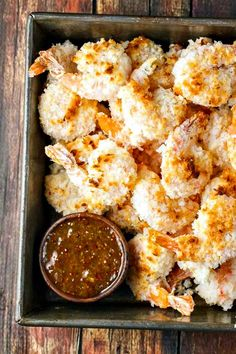 This Baked Coconut Shrimp recipe is so much easier and cheaper than take-out! The secret is dipping them first in whipped egg whites - it makes them as crunchy as fried! And the dip is FANTASTIC.