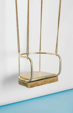 The Island Swing from the GOD project. Swing with brass structure hand-coated with gold foils and gold silk rope and fringes. Fun Design Ideas We Love at Design Connection, Inc. | Kansas City Interior Design http://www.designconnectioninc.com