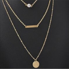 BRAND NEW TRIPLE LAYERED GOLD NECKLACE  Brand new beautiful layered necklace! This would be perfect to spice up any outfit! Also, the length is adjustable! LAST ONE! Jewelry Necklaces