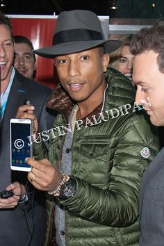 Pharrell Williams at the Liquipel booth inside the 2014 Consumer Electronics Show at the Las Vegas Convention Center on January 8, 2014 in Las Vegas, Nevada.