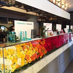 The custom floral product display counter at today's COVERGIRL Media Event is full of beautiful fresh flowers Bar Displays, Display Ideas, Portable Bar, Rainbow Theme, Event Design, Stage Design, Wedding Rentals, Event Styling, Covergirl