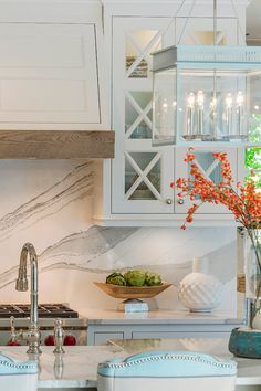 Marble-looking Cambria Brittanica Countertop and backsplash. Cabinets white dove.
