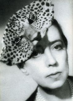 Elsa Schiaparelli wearing a real panther's head.