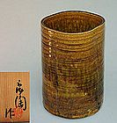 Pale green ash glaze mottles the sandy Seto striated sides of this large vase by Kato Shunto enclosed in the original signed wooden box. The vase is 10 inches (25 cm) tall, roughly 7 inches (17.5 cm) diameter and in fine condition. Shunto is a very highly esteemed Seto artist, some of his handicrafts held by Aichi prefecture as important cultural properties...