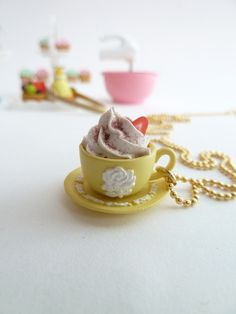 Fairy tales cup of coffee necklace with fake cupcake frosting marie antoinette tea party yellow Wedgwood cup. $16.99, via Etsy.