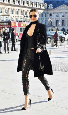 On Miranda Kerr: Oliver Peoples Benedict Aviator Sunglasses ($425); Dries Van Noten coat; Are You Am I Zillah Camisole ($179); Unravel pants; Gianvito Rossi Leather and PVC Pumps ($745); Emilio...
