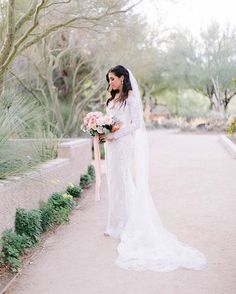 Pretty bride in her gorgeous wedding dress. I'm loving her lacy long sleeves that were so unique and romantic! Lacy Wedding Dresses, Gorgeous Wedding Dress, Outdoor Ceremony, Custom Jewelry, Trendy Fashion, Love Her, Romantic, Bride, Unique