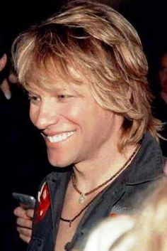 Jon Bon Jovi flashing that gorgeous smile. Is that a cold sore on his upper lip?! Let's hope it's just adult acne...